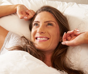 Smiling woman waking rested