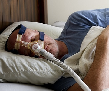 Man sleeping soundly with CPAP mask