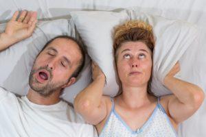 man snoring loudly woman upset