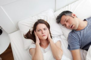 man snoring wife upset covering ears