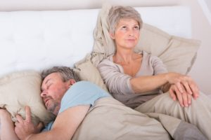 woman angry at husband for snoring