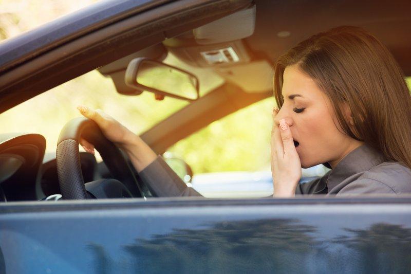 woman trying to stay awake suffering from dangerous sleep apnea
