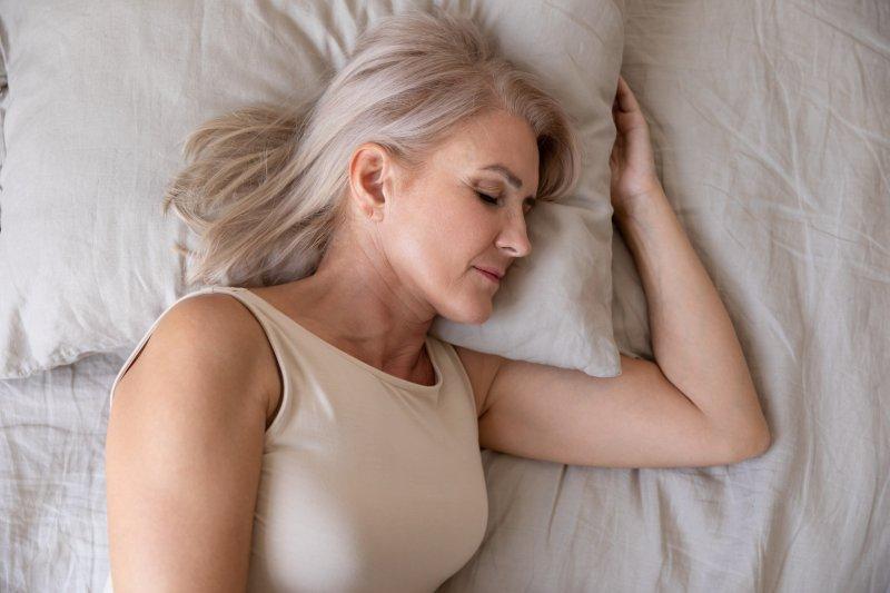 Older woman sleeping on her side