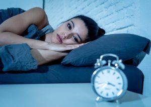 woman lying awake at night who needs a sleep apnea dentist
